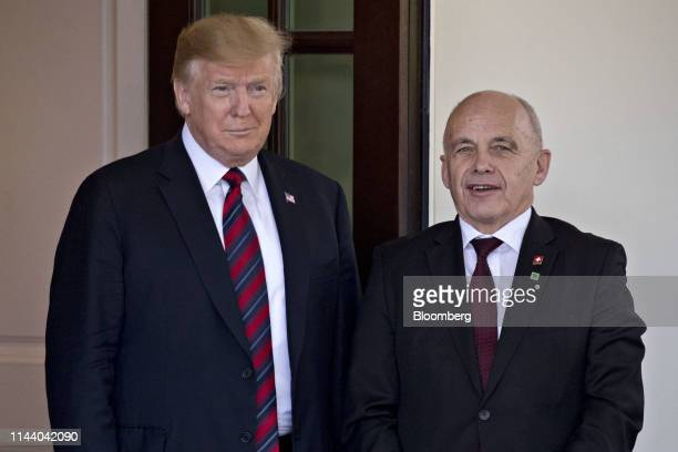 US President Donald Trump left stands with Ueli Maurer Switzerland's finance minister at the West Wing of the White House in Washington DC US on...