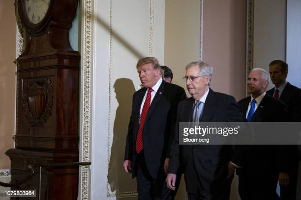 US President Donald Trump left walks with Senate Majority Leader Mitch McConnell a Republican from Kentucky center and US Vice President Mike Pence...
