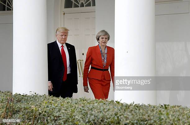 US President Donald Trump left walks with Theresa May UK prime minister outside of the White House in Washington DC US on Friday Jan 27 2017 The...