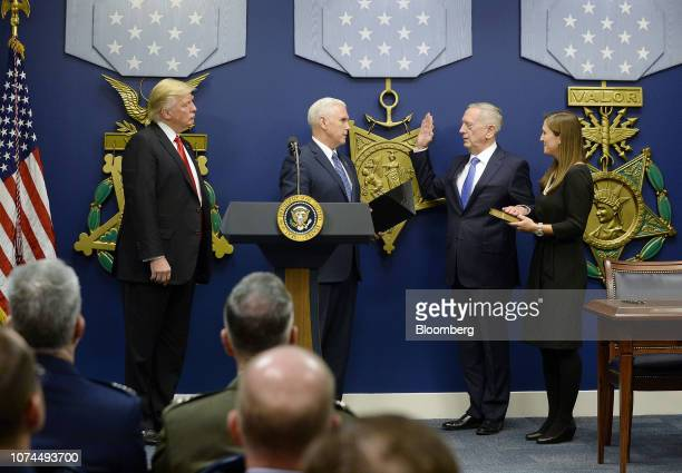 S President Donald Trump left watches as US Vice President Mike Pence second left swears in General James Mattis US secretary of defense in the Hall...