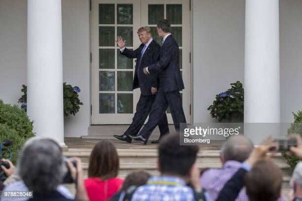 US President Donald Trump left waves while walking with Felipe VI Spain's king toward the Oval Office of the White House in Washington DC US on...