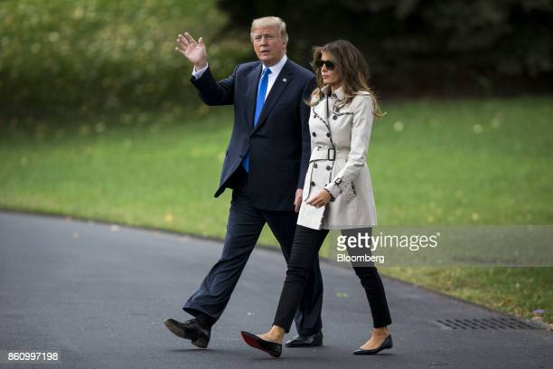President Donald Trump, left, waves while walking with First Lady Melania Trump to board Marine One on the South Lawn in Washington, D.C., U.S., on...