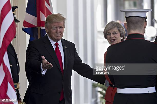 US President Donald Trump left welcomes Theresa May UK prime minister while arriving to the West Wing of the White House in Washington DC US on...