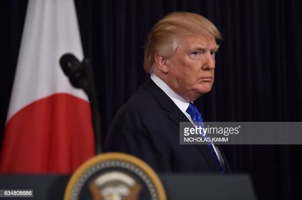 US President Donald Trump listen as Japanese Prime Minister Shinzo Abe speaks at Trump's MaraLago resort in Palm Beach Florida on February 11 after...
