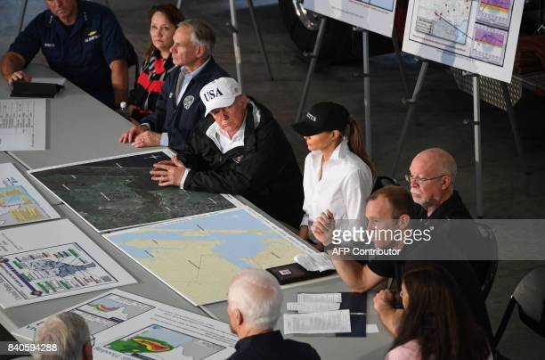 US President Donald Trump listens alongside Texas Governor Greg Abbott and First Lady Melania Trump during a firehouse briefing on Hurricane Harvey...