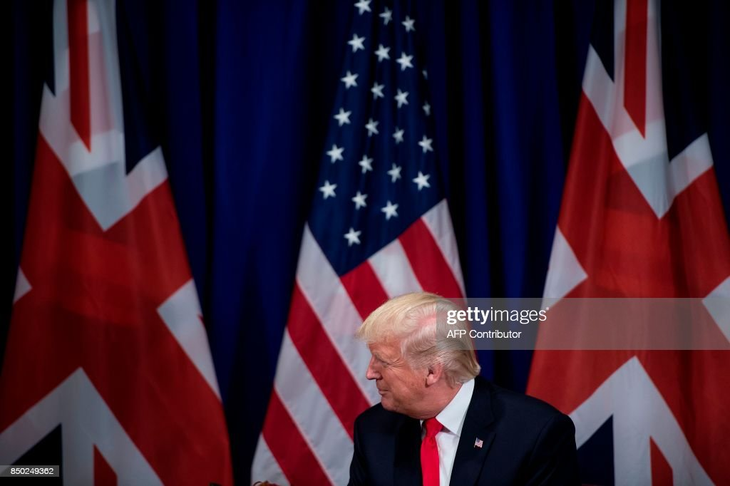 US President Donald Trump listens as Britain's Prime Minister Theresa May speaks before a a meeting at the Palace Hotel in New York, on the sidelines of the 72nd United Nations General Assembly, on September 20, 2017. / AFP PHOTO / Brendan Smialowski