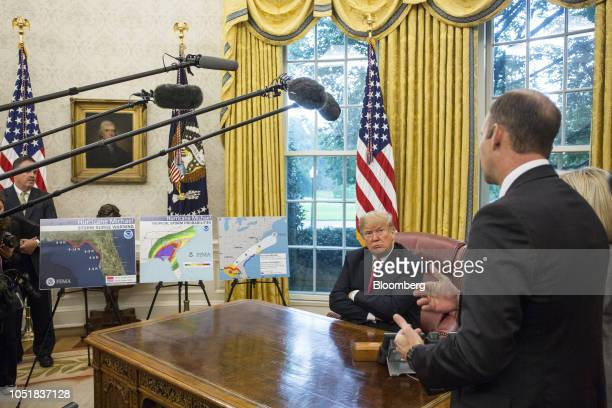 US President Donald Trump listens as Brock Long administrator of the Federal Emergency Management Agency speaks during a briefing on the federal...