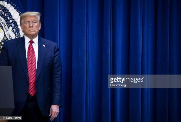 US President Donald Trump listens as Daria Ortiz granddaughter of murder victim Maria Fuertes not pictured speaks to members of the National Border...