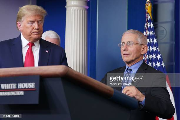 President Donald Trump listens as Director of the National Institute of Allergy and Infectious Diseases Anthony Fauci speaks during the daily...