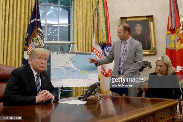 S President Donald Trump listens as FEMA Administrator Brock Long speaks while meeting with Long and Homeland Security Secretary Kirstjen Nielsen in...