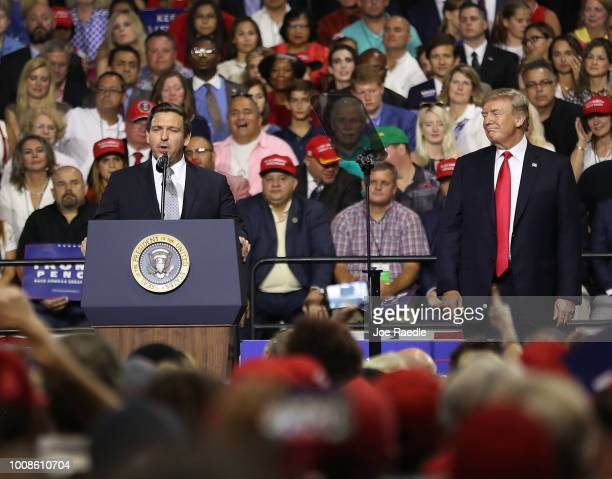 President Donald Trump listens as Florida GOP gubernatorial candidate Ron DeSantis speaks at a Make America Great Again Rally at the Florida State...
