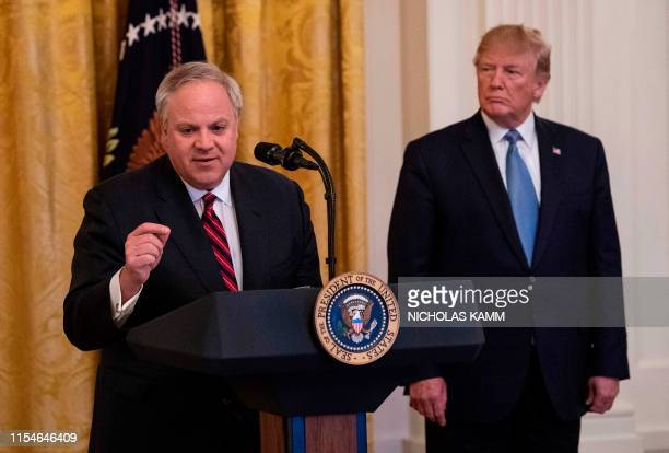 US President Donald Trump listens as Interior Secretary David Bernhardt speaks about the administration's environmental policies at the White House...