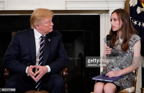 US President Donald Trump listens as Marjory Stoneman Douglas High School Carson Abt speaks during a listening session on gun violence with teachers...