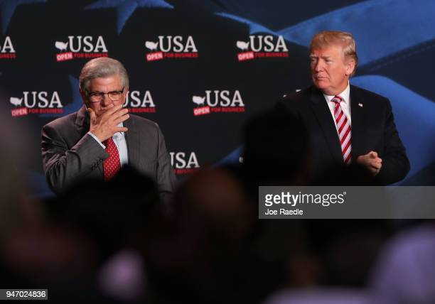 S President Donald Trump listens as Maximo Alvarez speaks during a roundtable discussion about the Republican $15 trillion tax cut package he...