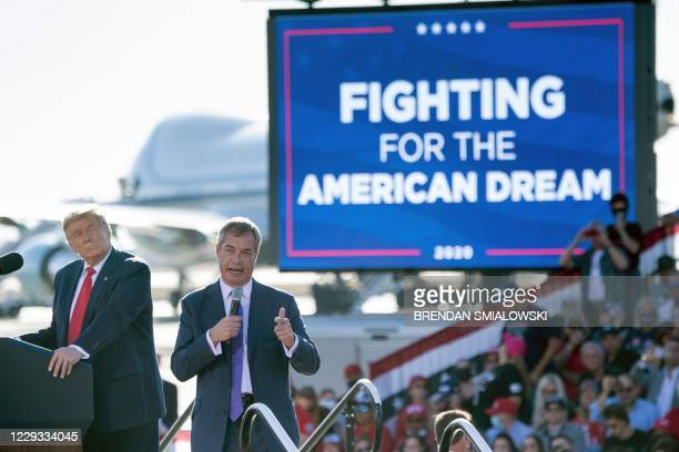 President Donald Trump listens as Nigel Farage speaks during a Make America Great Again rally at Phoenix Goodyear Airport October 28 in Goodyear,...