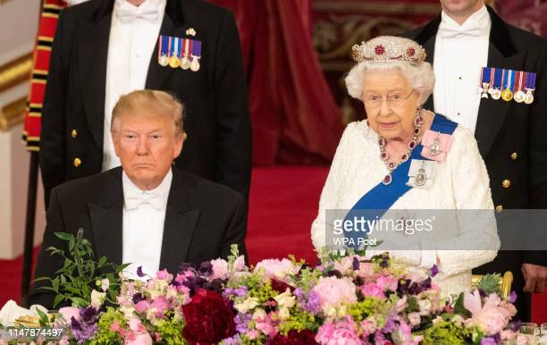 President Donald Trump listens as Queen Elizabeth II makes a speech during a State Banquet at Buckingham Palace on June 3, 2019 in London, England....
