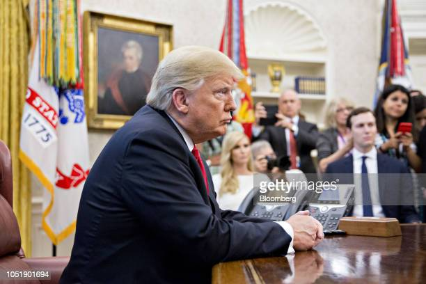 US President Donald Trump listens as rapper Kanye West not pictured speaks during a meeting in the Oval Office of the White House on Thursday Oct 11...