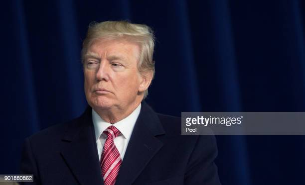 S President Donald Trump listens as Republican leadership takes turns speaking to the media at Camp David on January 6 2018 in Thurmont Maryland...