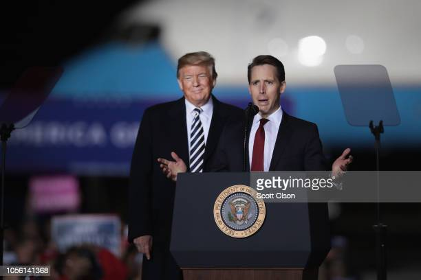 President Donald Trump listens as U S Senate candidate Josh Hawley speaks at a rally on November 1 2018 in Columbia Missouri Hawley is in a tight...