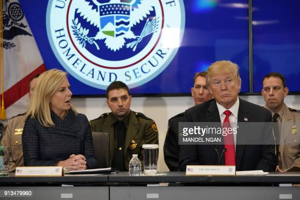 US President Donald Trump listens as US Homeland Security Secretary Kirstjen Nielsen speaks during a meeting at the Customs and Border Protection...