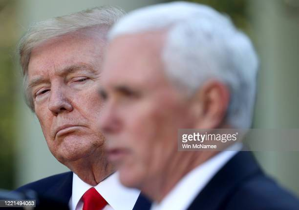 S President Donald Trump listens as Vice president Mike Pence answers questions during the daily briefing of the coronavirus task force in the Rose...