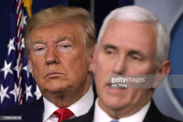 President Donald Trump listens as Vice President Mike Pence speaks during a news conference at the James Brady Press Briefing Room at the White House...