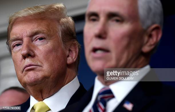 President Donald Trump listens as Vice President Mike Pence speaks about the COVID-19 alongside members of the Coronavirus Task Force in the Brady...