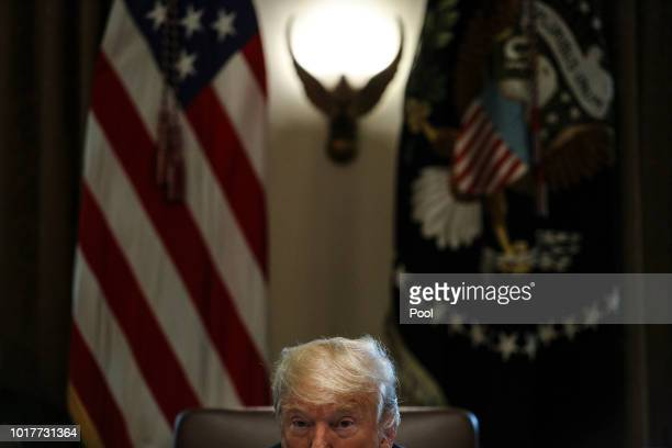 President Donald Trump listens during a cabinet meeting in the cabinet room of the White House on August 16 2018 in Washington DC