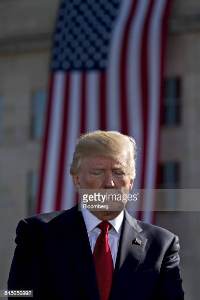 US President Donald Trump listens during a ceremony to commemorate the September 11 2001 terrorist attacks at the Pentagon in Washington DC US on...
