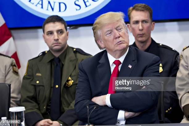 US President Donald Trump listens during a Customs and Border Protection roundtable discussion after touring the CBP National Targeting Center in...