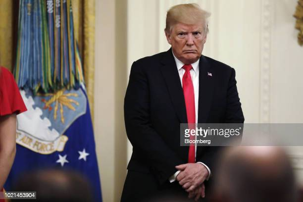 US President Donald Trump listens during a Medal of Honor ceremony at the White House in Washington DC US on Tuesday Aug 22 2018 Technical Sgt John...