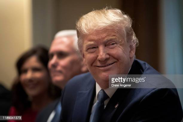S President Donald Trump listens during a meeting about the Governors Initiative on Regulatory Innovation in the Cabinet Room of the White House on...