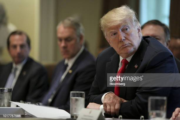 US President Donald Trump listens during a meeting in the Cabinet Room of the White House in Washington DC US on Thursday Aug 16 2018 Trump prodded...