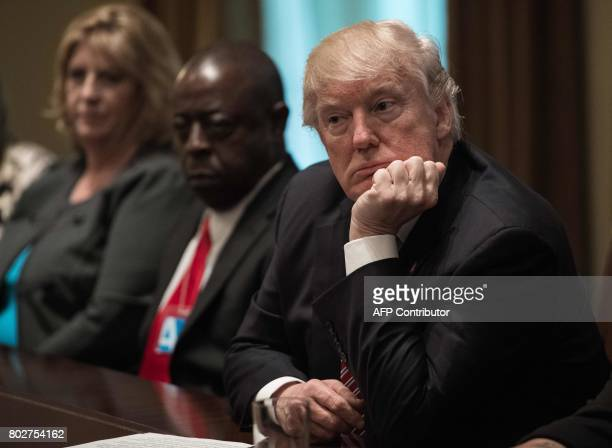 US President Donald Trump listens during a meeting to urge passage of bills to enforce federal laws on immigration in the Cabinet Room at the White...