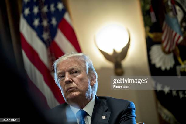 S President Donald Trump listens during a meeting with bipartisan members of Congress on immigration in the Cabinet Room of the White House in...
