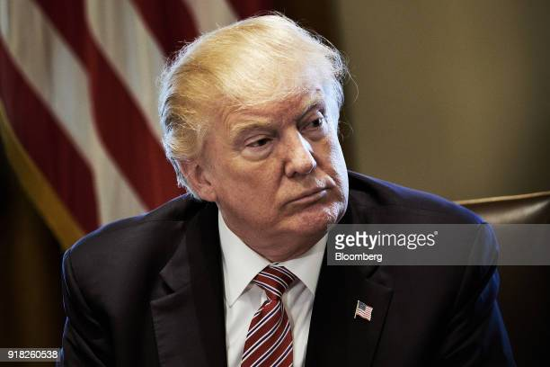 US President Donald Trump listens during a meeting with bipartisan members of congress in the Cabinet Room of the White House in Washington DC US on...