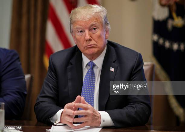 US President Donald Trump listens during a meeting with inner city pastors in the Cabinet Room of the White House on August 1 2018 in Washington DC
