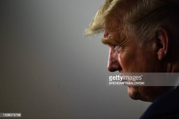 President Donald Trump listens during the daily briefing on the novel coronavirus, COVID-19, at the White House, March 23 in Washington, DC.