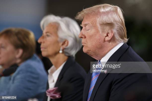 US President Donald Trump listens during the Group of Seven Gender Equality Advisory Council Breakfast at the G7 Leaders Summit in La Malbaie Quebec...