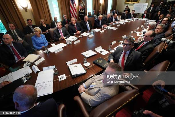 S President Donald Trump listens to a presentation during a cabinet meeting at the White House July 16 2019 in Washington DC Trump and members of his...