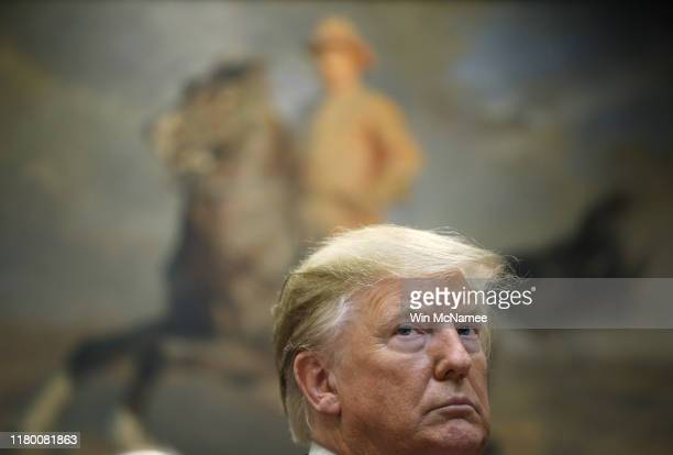 S President Donald Trump listens to a question from a reporter at an event for the signing of two executive orders aimed at greater governmental...