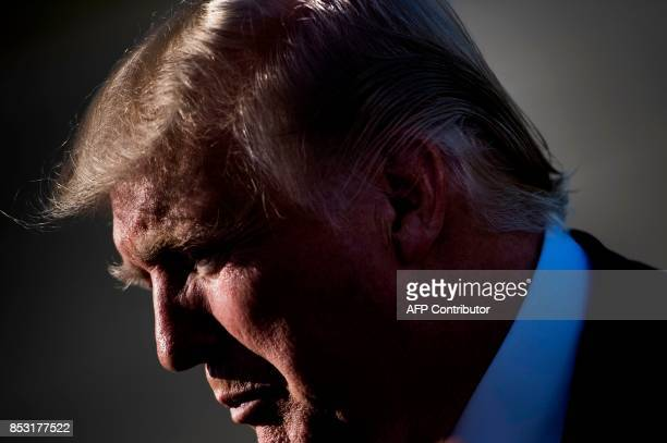 US President Donald Trump listens to a question from the press while boarding Air Force One at Morristown Airport September 24 2017 in Morristown New...