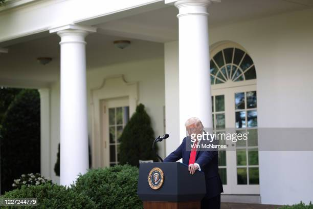 President Donald Trump listens to a reporter's question during an event on protecting seniors with diabetes, in the Rose Garden at the White House on...