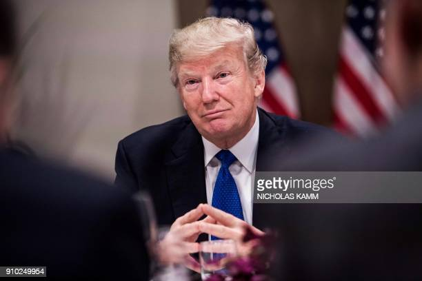 US President Donald Trump listens to a speaker during a working dinner with European business leaders during the World Economic Forum annual meeting...