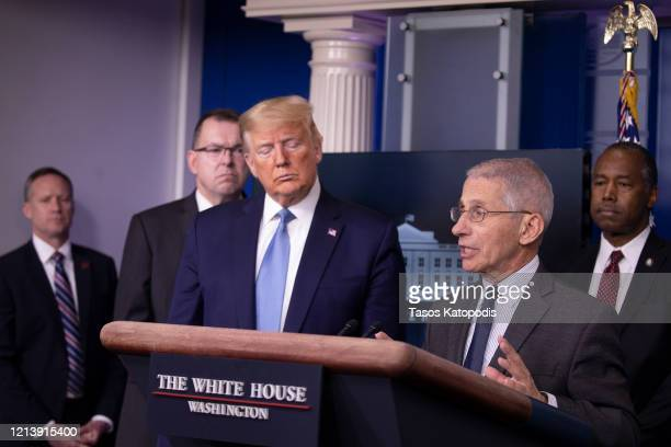 President Donald Trump listens to Anthony Fauci, Director of the National Institute of Allergy and Infectious Diseases speak during a briefing in the...
