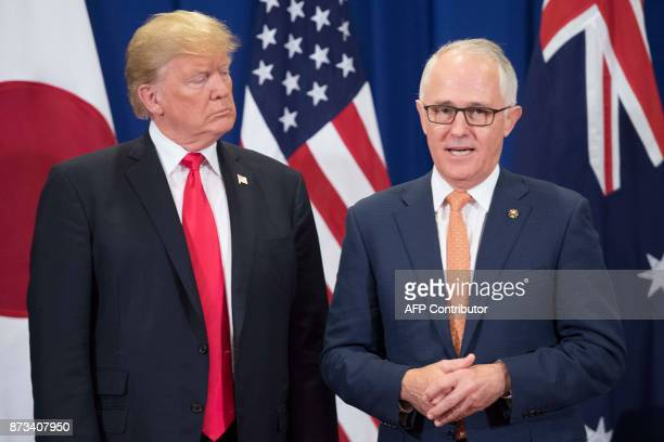 US President Donald Trump listens to Australia Prime Minister Malcolm Turnbull during the opening ceremony of the 31st Association of South East...