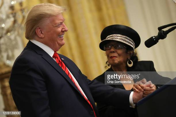 S President Donald Trump listens to civil rights icon Gertrude Jane Holliday Stone as she praised him during a Black History Month reception in the...