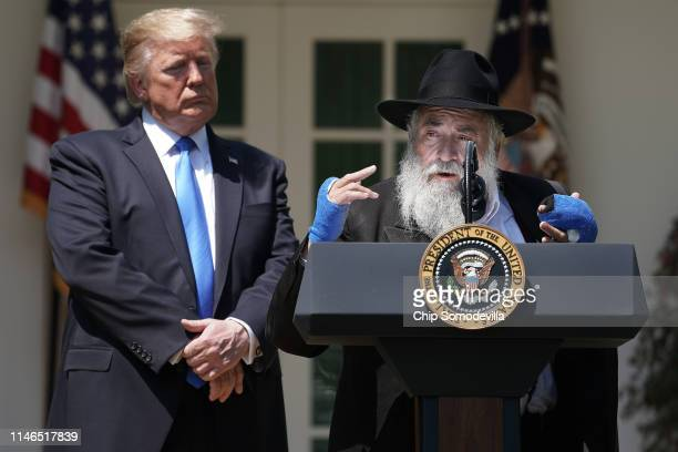President Donald Trump listens to Congregation Chabad Rabbi Yisroel Goldstein of Poway, California, speak during a National Day of Prayer service in...