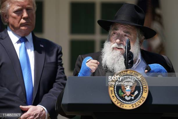 S President Donald Trump listens to Congregation Chabad Rabbi Yisroel Goldstein of Poway California speak during a National Day of Prayer service in...
