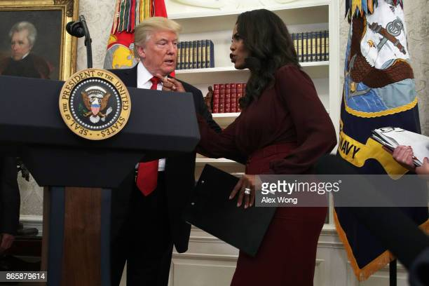 S President Donald Trump listens to Director of Communications for the White House Public Liaison Office Omarosa Manigault during an event in the...